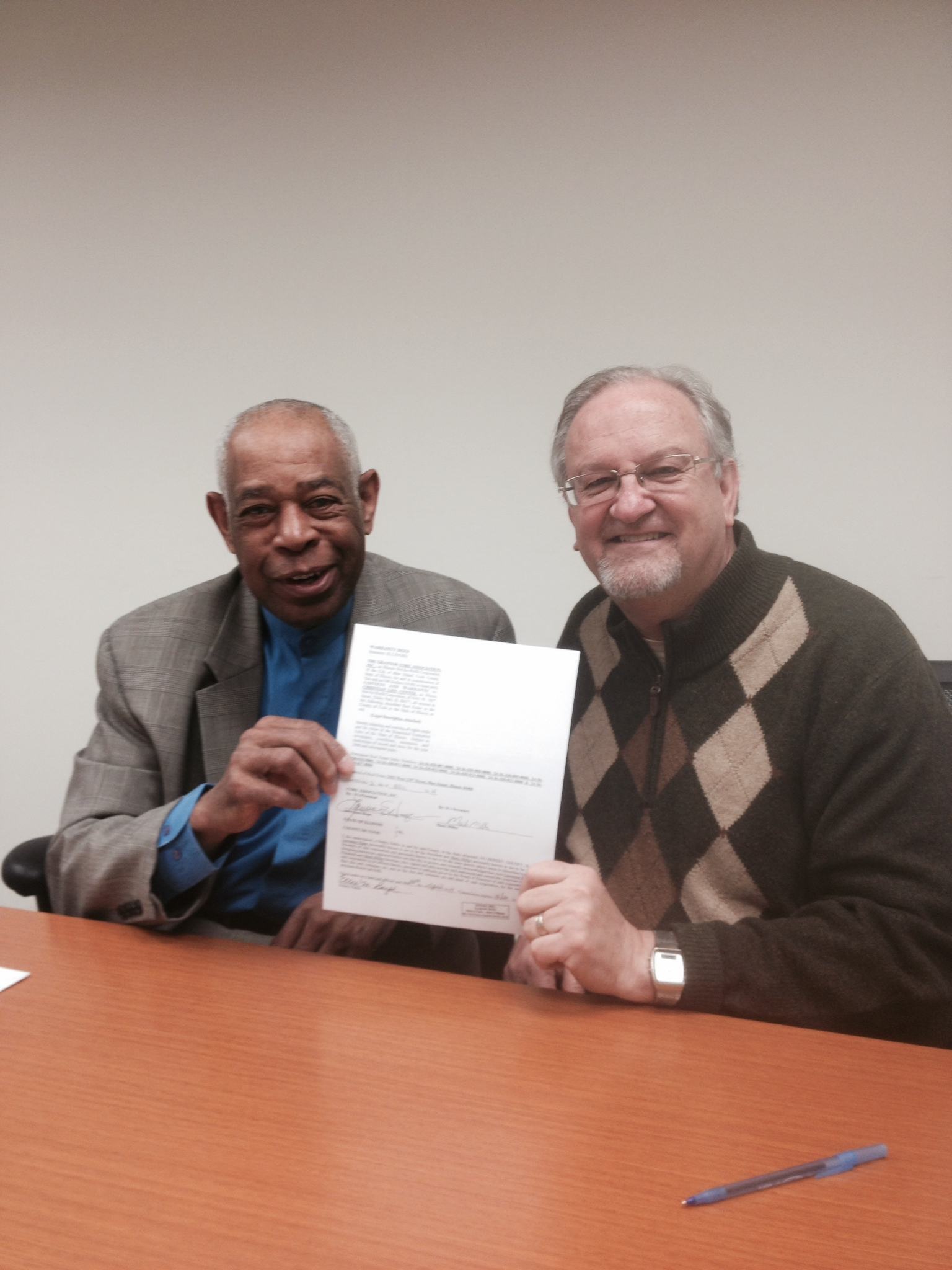 CLC Corporate Secretary, Jack Starks & me holding the DEED to the Blue Island property!