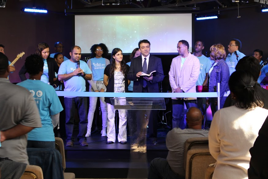 At the Blue Island Grand Opening today, Pastor William officially opened the church with a ribbon-cutting ceremony