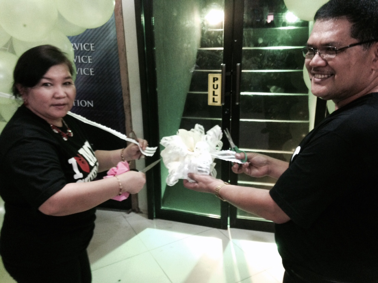 Pastors Herley & Nelly Montes cut the ribbon to officially open the doors to CLC-Davao's new building
