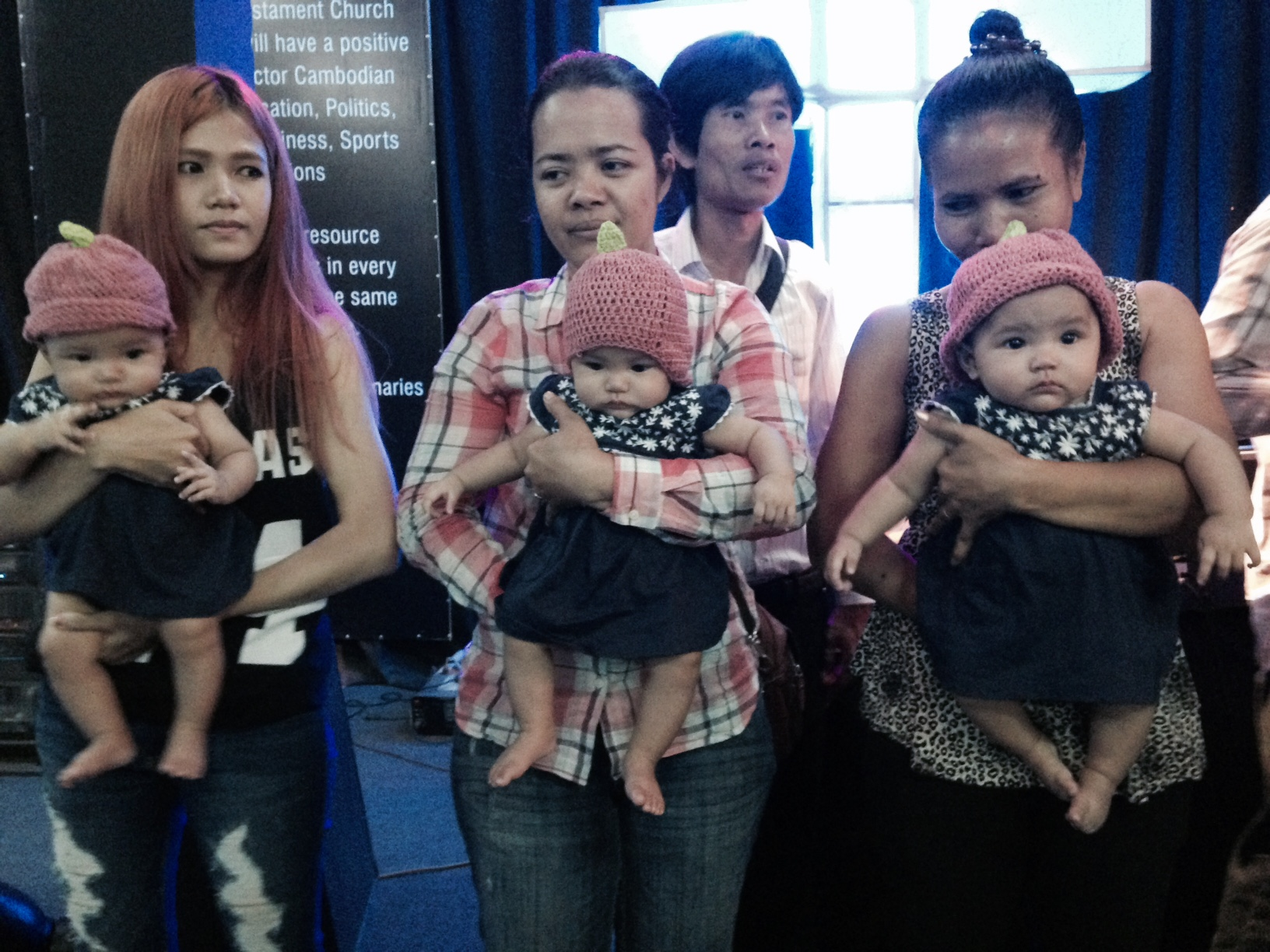 Probably the MOST fun of the day was dedicating 14 babies to the Lord, including these set of triplets!  (So rare in Cambodia, the Prime Minister came to visit them, and has awarded them full ride scholarships all the way through college!)  Aren't they adorable!!!