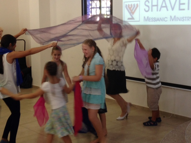 Not only did we adults sing & praise the Lord, but the children danced under a 'canopy' of His love as well!