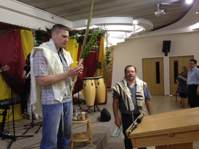 Associate pastor Dimi (L) pronounced Hebraic blessings for the upcoming holiday of Succot, as Rabbi Leon Mazin (R) spoke them over the congregation.