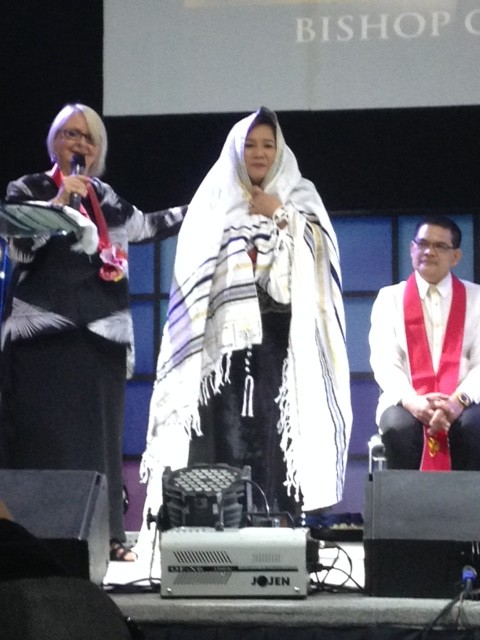 "Chris presented Pastora Nelly Montes with a ""talit"" (prayer shawl from Israel), as Bishop Herley's chief intercessor."
