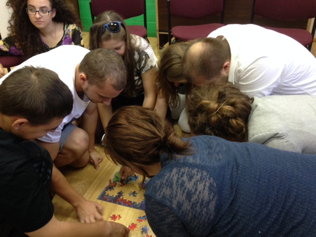 After a quick shwarma for lunch, we returned for a meeting with the small group of youth - and the Queen of Object Lessons had them put together a puzzle to open her message.