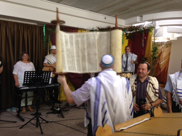 Then the Torah was returned to its resting place in the Ark.