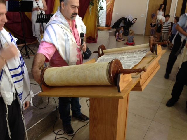 After the Torah is presented, the Cantor reads the weekly selection from Old & New Testaments - but it's done in a 'singing' style that you just have to experience (I can't explain it)