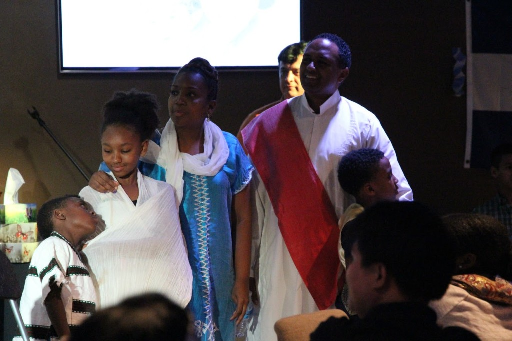 The Debela family won a prize for authentic national attire, representing Kenesa's homeland of ETHIOPIA!
