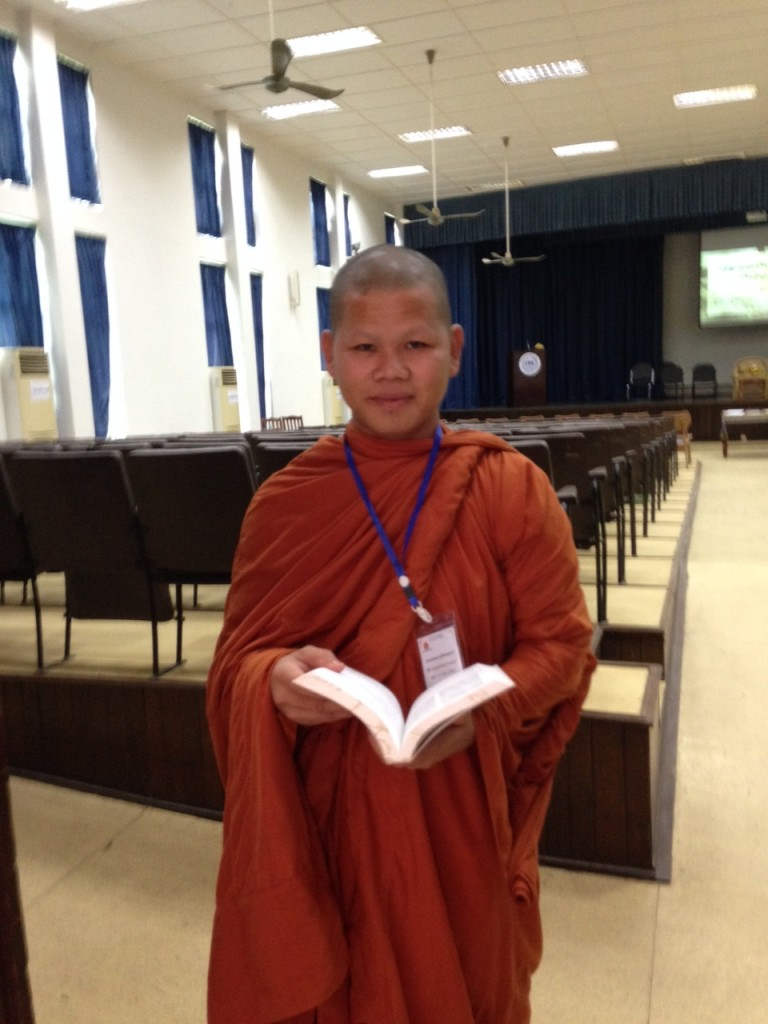 One of the Bibles went to this young Buddhist monk-in-training.  When I saw him thumbing thru it, I asked if I could take his picture.  May he hunger for Your truth, oh Lord!