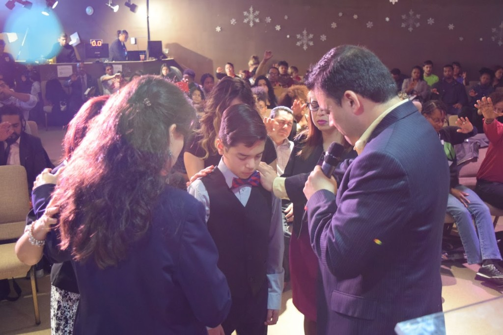 Love this story from our Blue Island campus: the young man in center is Ricky; he has been raised by his mother & grandmother & realized that he had not been dedicated as a baby, so HE asked if he could be dedicated!  Pastors William & Melek led the prayer over him-