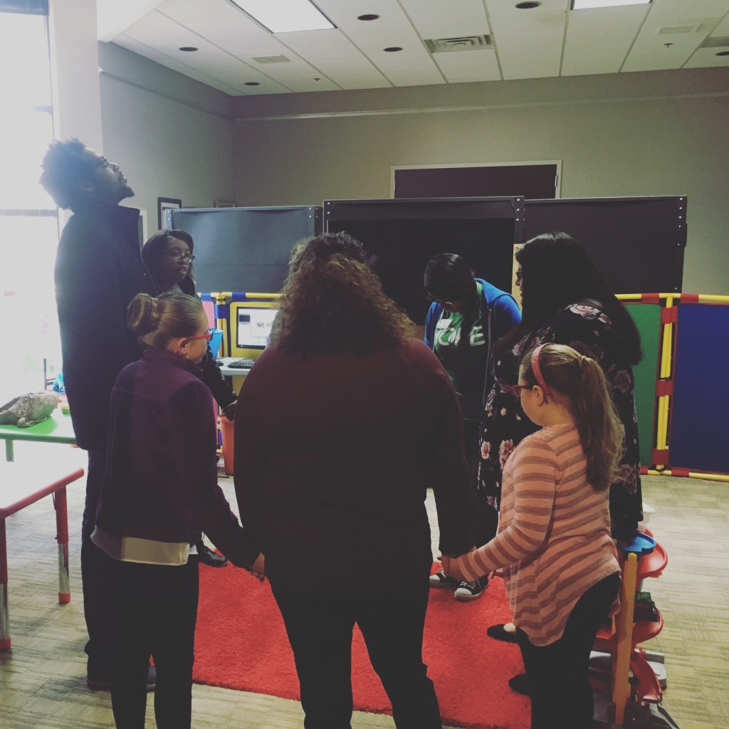 "Pastor Sam says ""our NWI campus started 2.5 years ago with a prayer meeting, and ended today with praying around the altar for our new city.  This pic is our KidsLife team praying together before service!"