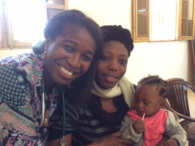 Dr. Mope Akintorin (L) was able to lead this young Muslim mother to Jesus!