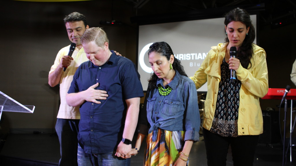 ...then he & Melek passed the baton in prayer to Pastors Brent & Sol