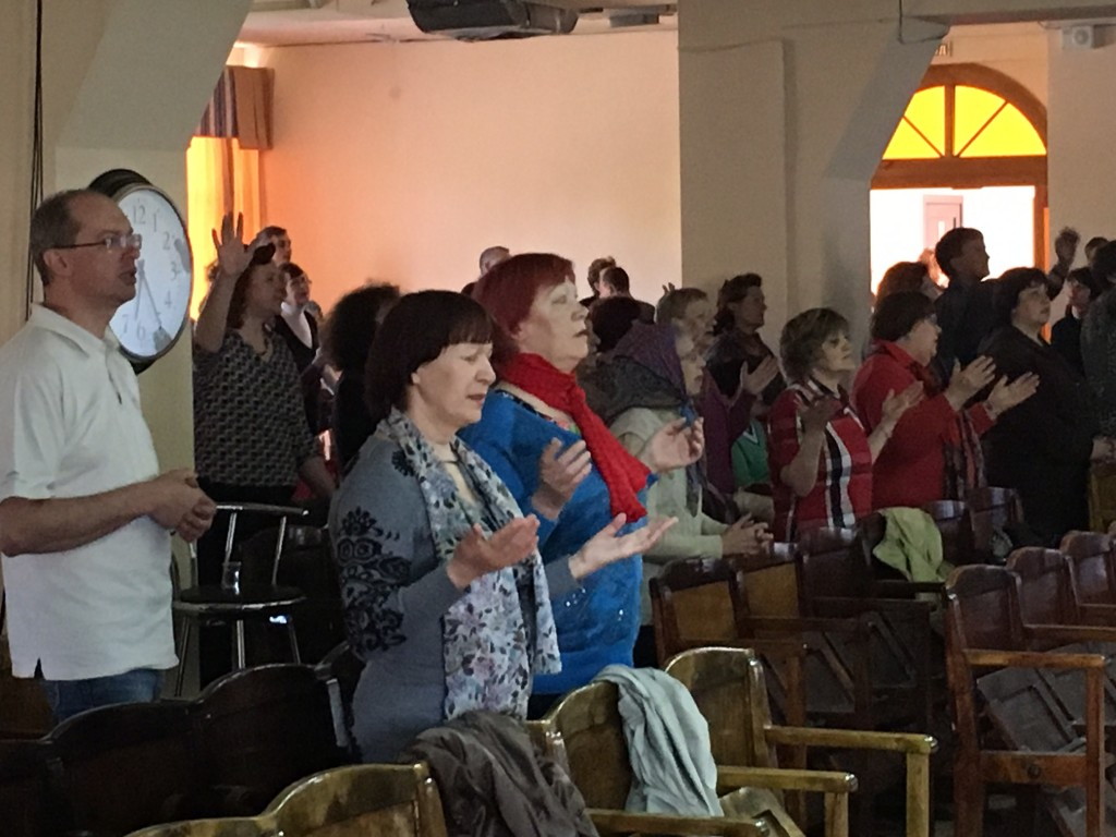 Siberians may be reserved by American standards, but these folks came to worship & pray!