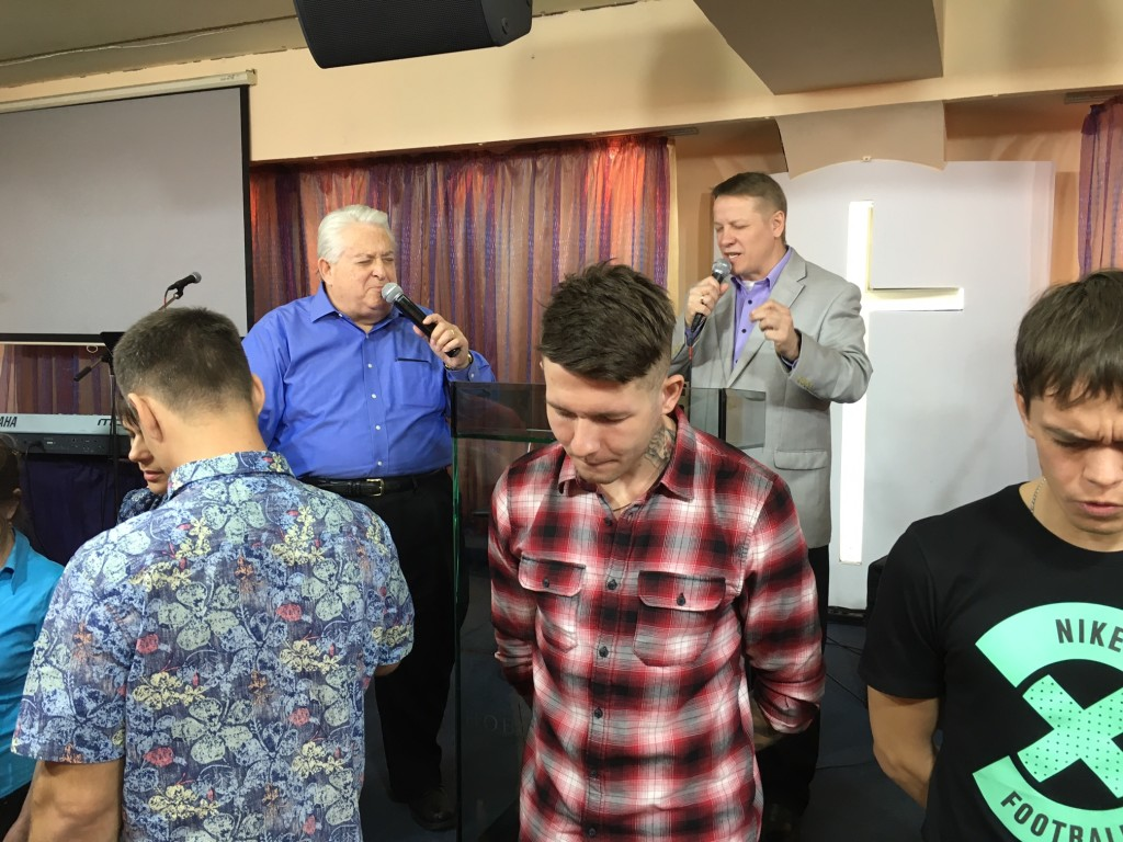After I preached on the Great Commission, the recent missionary school graduates were called forward - many of them will soon begin planting churches in Siberia.  (David Shibley led this prayer over the group of about 20 couples)