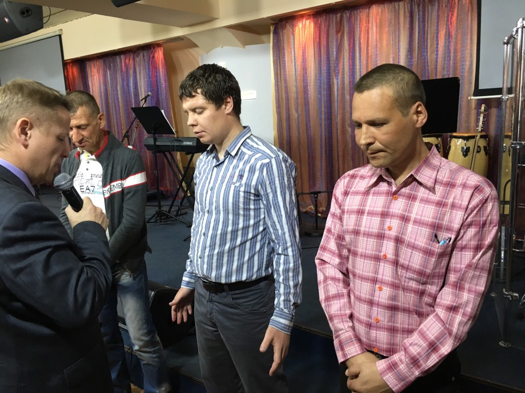 3 men gave their lives to Jesus tonight! (Pastor Ilya is leading them in a sinner's prayer)