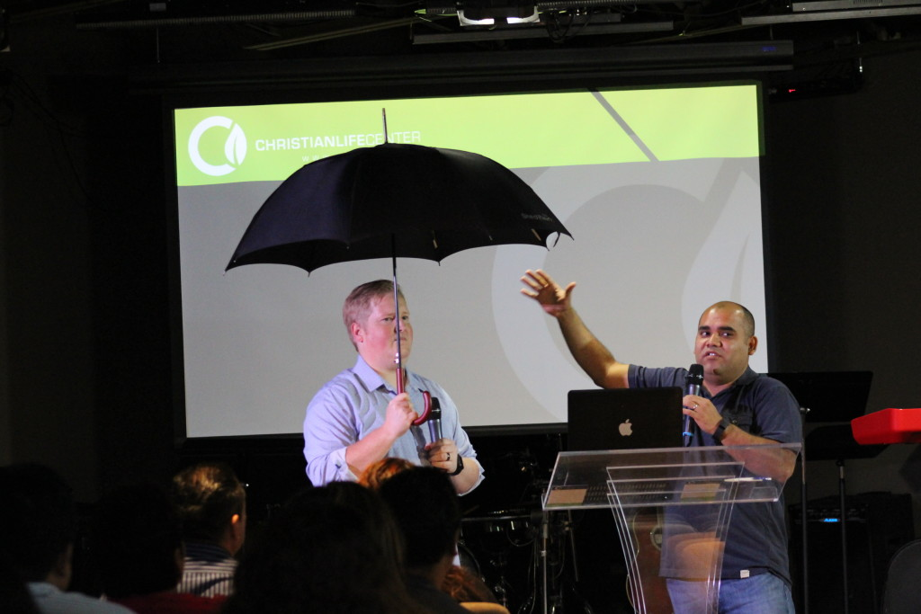 Pastor Brent illustrated the benefit of being under the umbrella (covering) of an anointed local church
