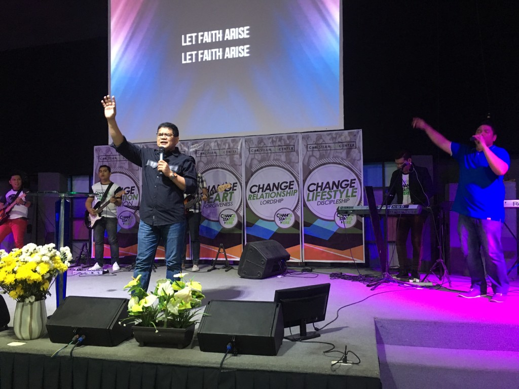 Bishop Herley Montes exhorting us before we received communion together (CLC'ers note Erik in the red pants, still shredding the guitar!)