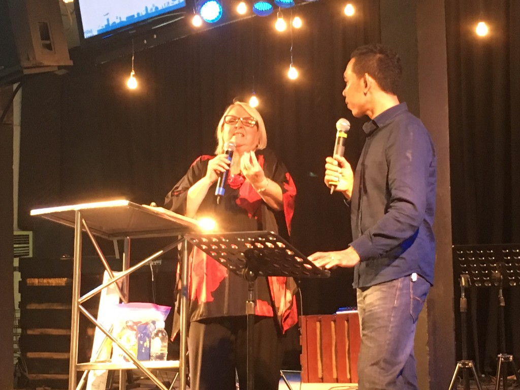 Chris preached her heart for missions tonight, and the altar response was amazing, as Cambodians streamed forward to offer themselves for the Lord's work (I wish you could have seen them, but I didn't intrude w/pictures because I was busy praying with so many)
