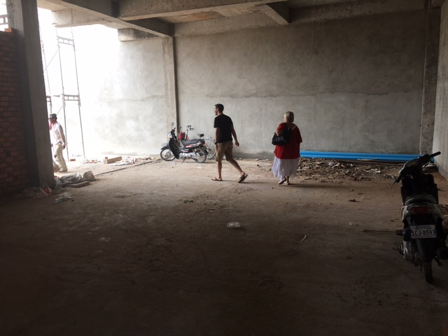 Jesse & Chris walking thru the new entrance to their building-