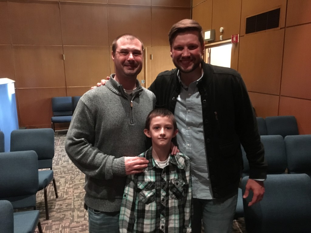 "Today was the FIRST TIME he young boy pictured here with his dad & Pastor Sam had EVER stepped foot in any church and he was one of three who gave his life to the Lord today! (Afterwards, he said to Pastor Sam, ""I'll see you next week!"")"