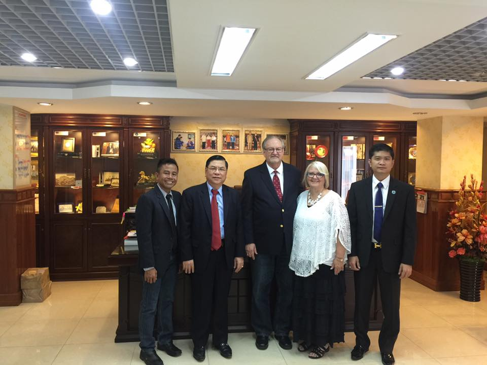 (LtoR) Pastor Mara Kong representing New Life Foundation; His Excellency Mr. Ly Chheng, President of Beltei University, me & Chris, & Mr. Chheng's youngest son, who is Vice-President of the University