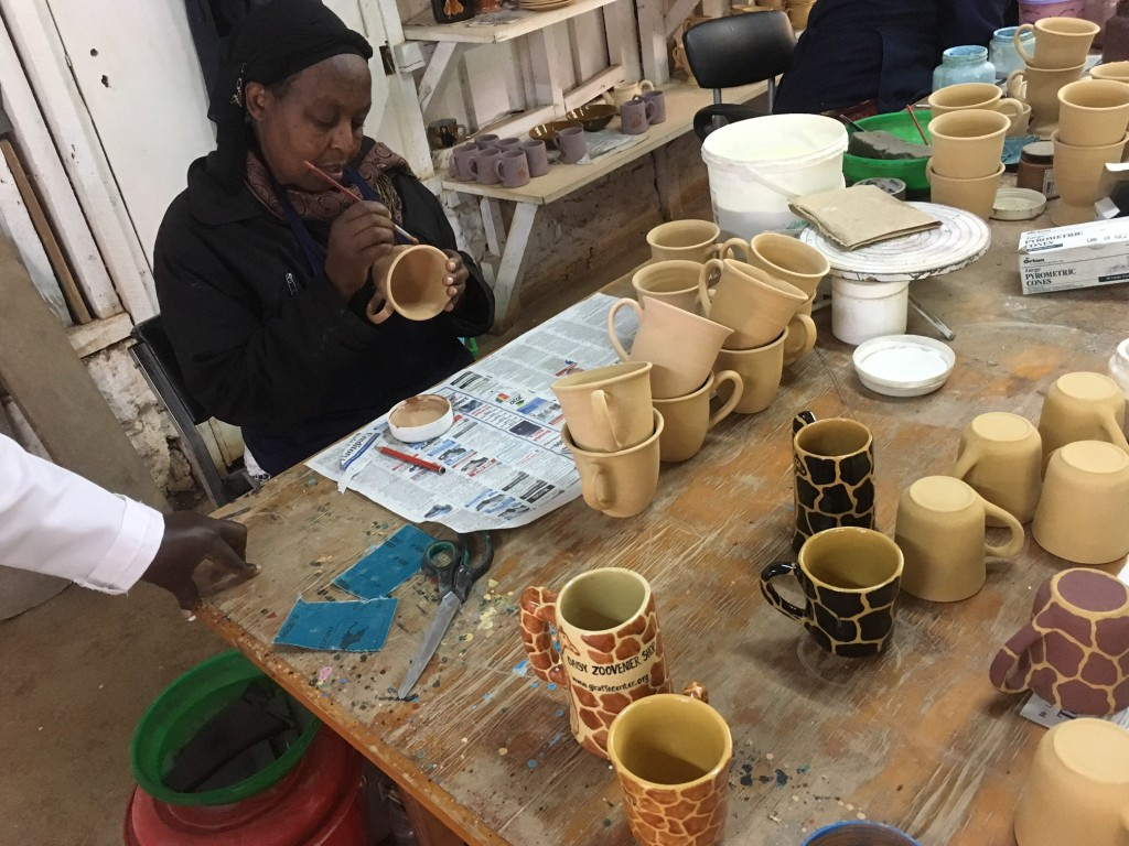 afterwards, some women paint the various pottery pieces in a wonderful variety of designs.