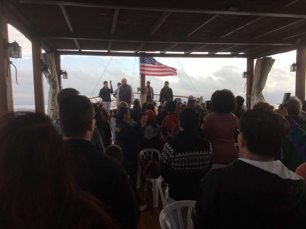 "Because of yesterday's storm, no boats operated on the Sea of Galilee, so we joined in with a church group from Singapore today.  Both flags were raised when we left shore to the ""Star Spangled Banner"""