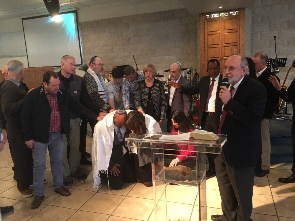 The highlight of our Sabbath service at 'Tents of Mercy' was the ordination of Avishalom & his wife as senior leaders of the ministry.  Our long-time partner, Eitan Shishkoff, who founded the ministry, will be moving into an apostolic role throughout the nation. Other partners of CLC are pictured here praying over Avishalom - Leon Mazin of 'Return to Zion' in Haifa (at left, with his hand on Avishalom), Dan & Patty Juster, Tikkun Directors (left & center of pic), Asher Intrater of 'Revive Israel' in Jerusalem (behind pulpit, next to Patty), and Eitan Shishkoff (far right)