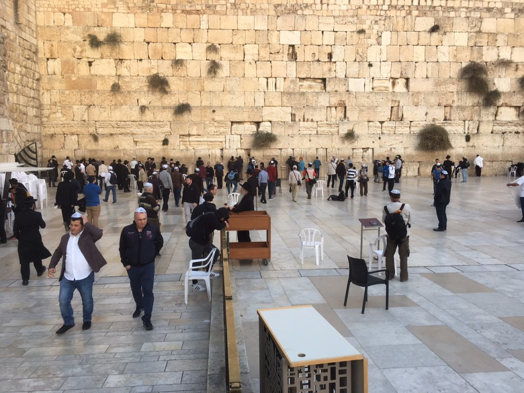 """We closed our day's tour at the holiest site in all of Israel (or in all the world) - the Western Wall.  (This is the retaining wall that surrounded the Second Temple, which was completely destroyed in 70 A.D.)  Since the Holiest of Holies was closest to this western wall, people gather here to pray, giving it the nickname, """"Wailing Wall"""".  As a sign asking for all to respect the place says, this is """"where the Divine Presence always rests""""!  It's always a privilege to pray here-"""