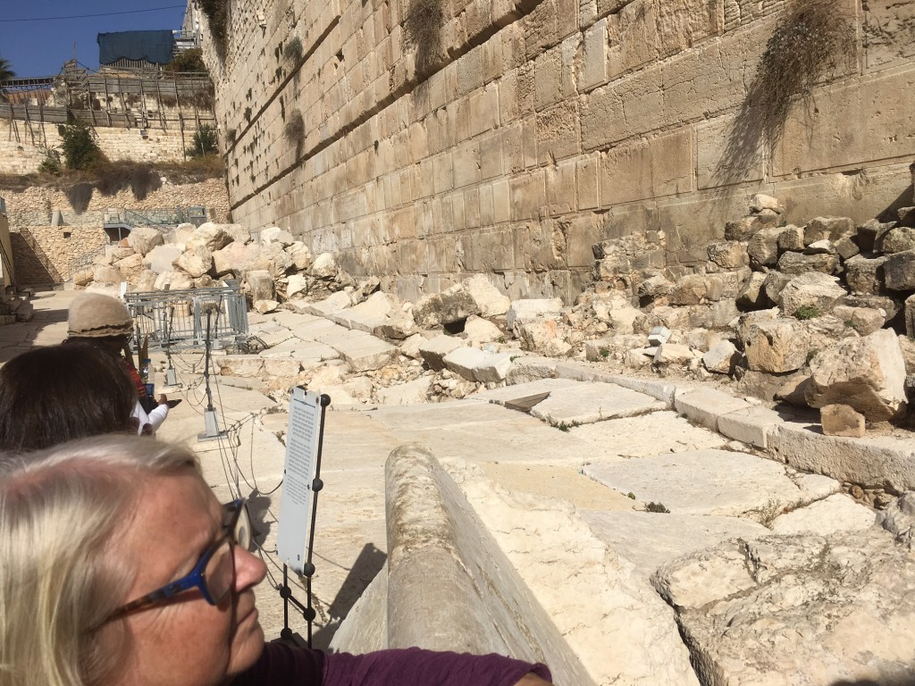 Just as Jesus prophesied, when the Romans destroyed the temple in 70 A.D., they didn't leave one stop atop another.  They also started to tear down the retaining wall around the Temple Mount by pushing the stones off the top, but it soon became too much work (since the smallest stone weighed 2.5 tons!) and that's why we have a Western Wall where  people can gather to pray.  This picture shows some of those original stones still laying where the Romans pushed them down.