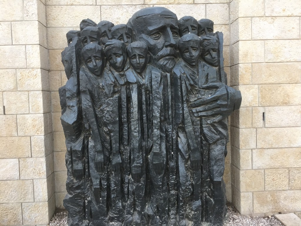 "We ended our day at the ""heaviest"" place in Israel - Yad Vashem - the memorial to the 6 million Jews who were murdered in the Holocaust.  Perhaps the saddest part is the Children's memorial for 1.5 million children who died - and this sculpture is in honor of Janusz Korczak, a medical doctor who cared for almost 200 orphans during the Holocaust, and when the Final Solution came, he refused the Germans offer to spare his life and chose instead to die with this 'children' in the gas chambers."