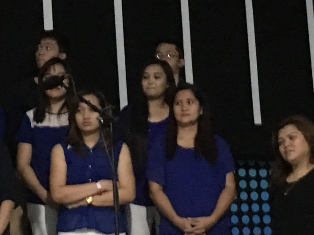 And his mom was singing in the choir (front row, center)