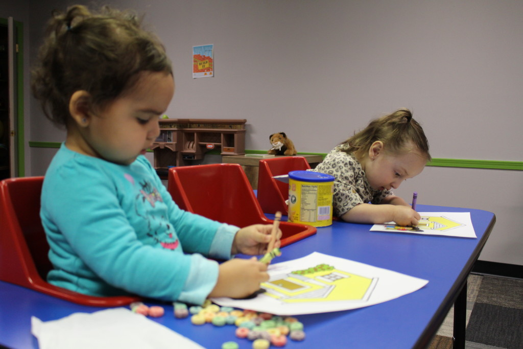 Who said KidsLife is all fun & games? Sometimes it's hard work that requires great concentration! Just ask these two cuties-