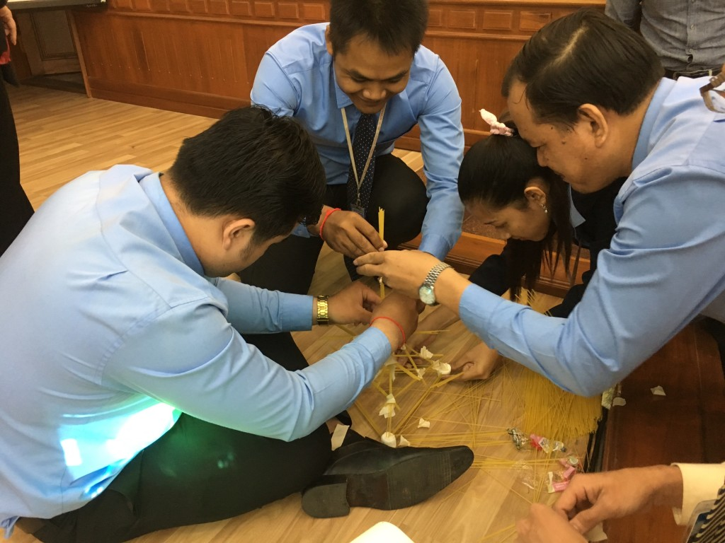 "while this team of Faculty members & students won 1st place for building the ""tallest tower"" with spaghetti noodles, marshmallows & masking tape!"