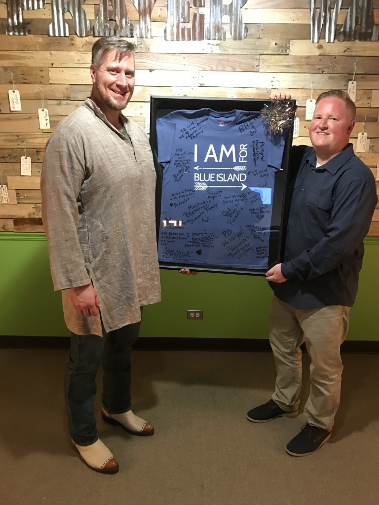 "Our Blue Island campus said their goodbyes to Pastor Ben today by presenting him an autographed ""I Am for Blue Island"" t-shirt"
