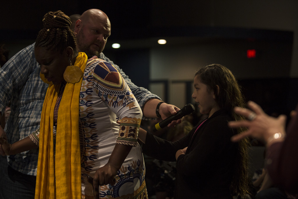 Most important of all were the healings that happened all over the house - and so neat to see this little girl follow Robby's instructions to minister healing to N'kyenge Brown, whose mother told me afterwards that she hadn't been able to move that freely in so long!