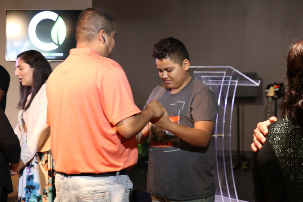 At the close of service, the team who had gone to Siberia ministered in the altar to anyone who wanted prayer - including the youngest member of the team (Joel Mendez) who was just 12 years old - but he ministered in the altar with the others!