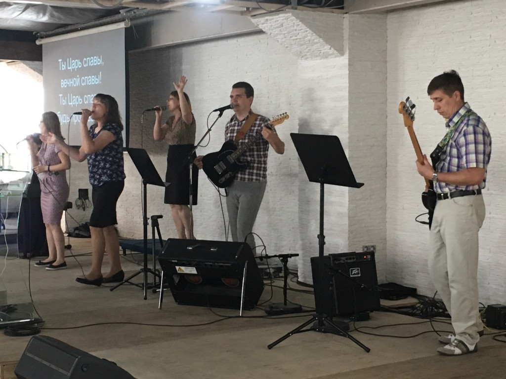 The praise team may be small, but they're a talented bunch! The man in the microphone can shred a lead guitar!