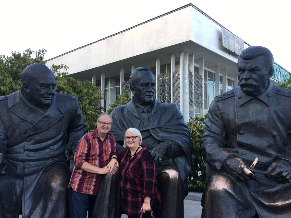 Posing with the main characters of the conference: Winston Churchill, Franklin Delanor Roosevelt & Joseph Stalin (at the monument outside the Livadia Palace)