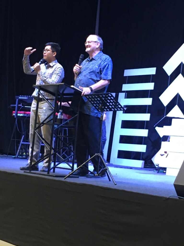 Preaching at New Life Fellowship with the help of Executive Pastor Samady translating into Khmer.