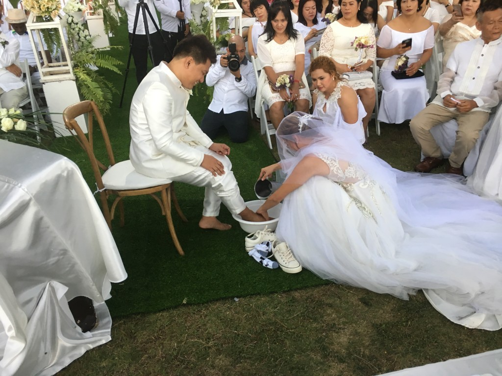 something I'd never seen done at a wedding before: Joy washed Erik's feet to let him know that she respects him & submits to him as the head of their new family