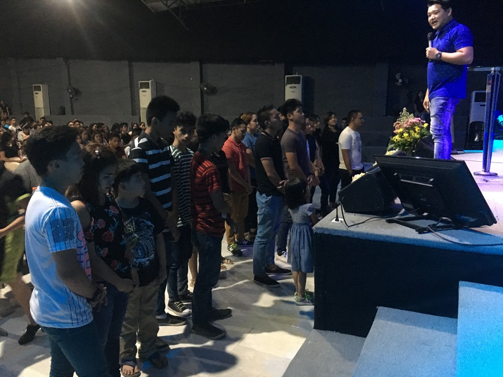 some of the first-time guests who came forward to receive the Lord after one of our services in Davao