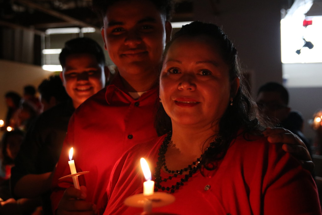 There's something sweet about families worshipping together by candlelight!